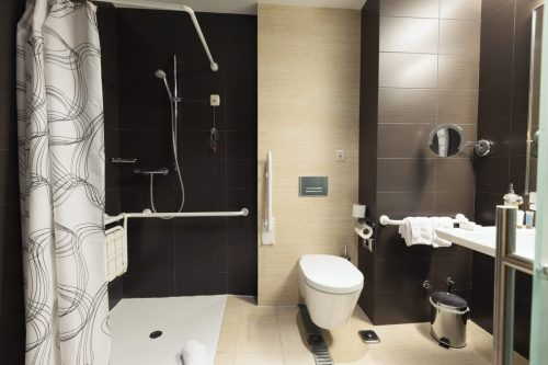 A black Disabled Shower in a mobility bathroom - Age are Bathrooms